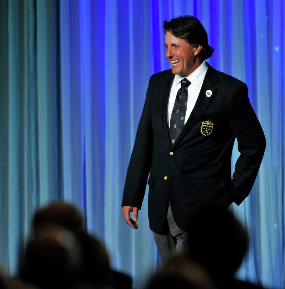 Phil Mickelson smiles during his induction into the World Golf Hall of Fame on Monday, May 7, 2012,in St. Augustine, Fla. Mickelson was inducted along with two-time major champion Sandy Lyle of Scotland, writer Dan Jenkins, British player and broadcaster Peter Alliss and LPGA player Hollis Stacy. The induction ceremony Monday night at the World Golf Village brought the Hall of Fame membership to 141. (AP Photo/The Florida Times-Union, Will Dickey) Photo: Will Dickey