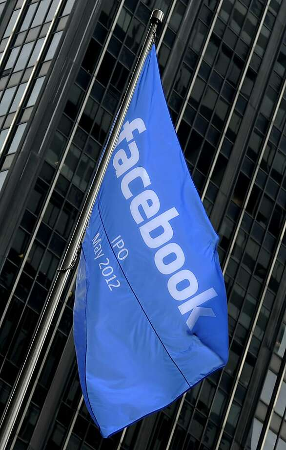 A Facebook Inc. IPO announcement flag flies outside of JPMorgan Chase & Co. headquarters in New York, U.S., on Friday, May 4, 2012. Facebook Inc. will play up its prospects for expanding in mobile advertising when it begins pitching its initial public offering to investors in New York, Boston and Silicon Valley next week. Photographer: Peter Foley/Bloomberg Photo: Peter Foley, Bloomberg