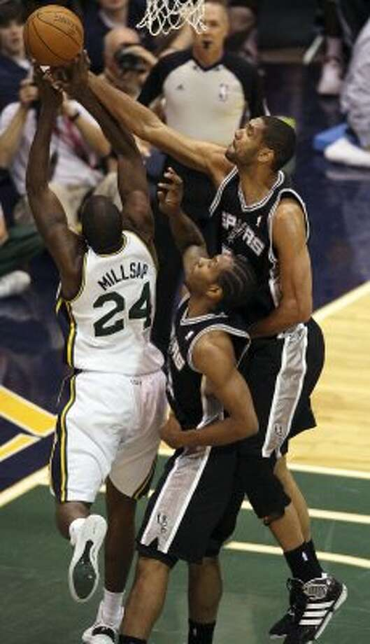 The Spurs'  Tim Duncan and Kawhi Leonard surround the Jazz's Paul Millsap during the first half of Game 4 in the Western Conference first round at EnergySolutions Arena in Salt Lake City, Monday, May 7, 2012.   Jerry Lara/San Antonio Express-News (Jerry Lara / San Antonio Express-News)