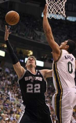 The Spurs' Tiago Splitter shoots around Jazz's Enes Kanter during first half action of Game 4 of the Western Conference first round Monday May 7, 2012 at EnergySolutions Arena in Salt Lake City, Utah. EDWARD A. ORNELAS/SAN ANTONIO EXPRESS-NEWS (EDWARD A. ORNELAS / SAN ANTONIO EXPRESS-NEWS)