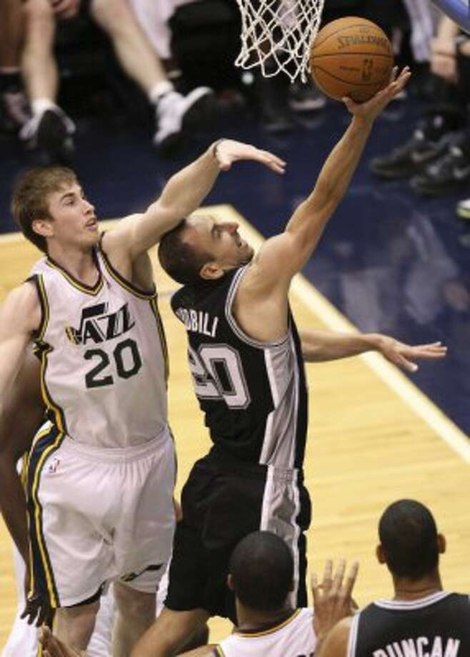 The Spurs'  Manu Ginobili gets through the Jazz's Gordon Hayward during the first half of game four in the Western Conference first round at EnergySolutions Arena in Salt Lake City, Monday, May 7, 2012.   Jerry Lara/San Antonio Express-News (Jerry Lara / San Antonio Express-News)