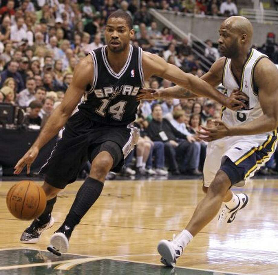 The Spurs' Gary Neal drives around Jazz's Jamaal Tinsley during first half action of Game 4 of the Western Conference first round Monday May 7, 2012 at EnergySolutions Arena in Salt Lake City, Utah. EDWARD A. ORNELAS/SAN ANTONIO EXPRESS-NEWS (EDWARD A. ORNELAS / SAN ANTONIO EXPRESS-NEWS)