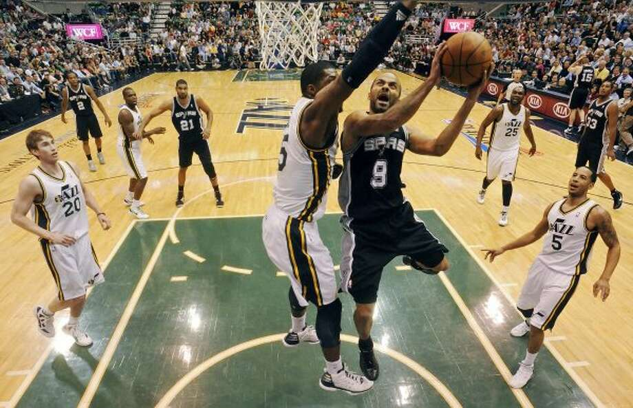 The Spurs' Tony Parker drives to the basket around Jazz's Derrick Favors during first half action of Game 4 of the Western Conference first round Monday May 7, 2012 at EnergySolutions Arena in Salt Lake City, Utah. EDWARD A. ORNELAS/SAN ANTONIO EXPRESS-NEWS (EDWARD A. ORNELAS / SAN ANTONIO EXPRESS-NEWS)