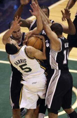The Spurs'  Manu Ginobli, Kawahi Leonard and Gary Neal stop the Jazz's Devin Harris during the first half of Game 4 in the Western Conference first round at EnergySolutions Arena in Salt Lake City, Monday, May 7, 2012. Neal was called for a foul on Harris on the play. Jerry Lara/San Antonio Express-News (Jerry Lara / San Antonio Express-News)