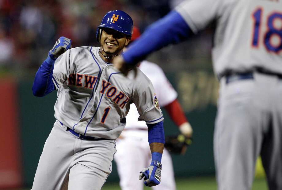 New York Mets' Jordany Valdespin, left, smiles as he rounds the bases after hitting a three-run home run off Philadelphia Phillies relief pitcher Jonathan Papelbon in the ninth inning of a baseball game, Monday, May 7, 2012, in Philadelphia. New York won 5-2. (AP Photo/Matt Slocum) Photo: Matt Slocum