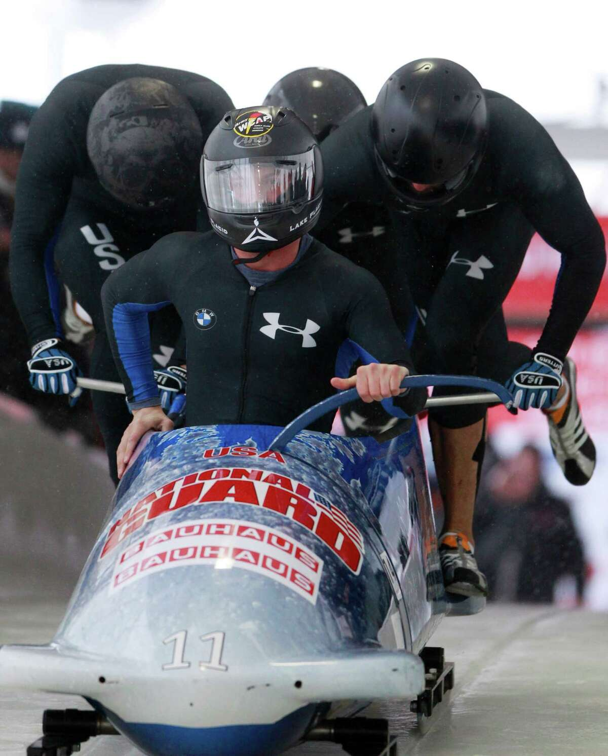 USA's pilot John Napier, front, with pushers Charles Berkeley, Adam Clark and brakeman Christopher Fogt, start their first heat in the men's four-man Bobsled World Championships in Lake Placid, N.Y., on Saturday, Feb. 25, 2012. (AP Photo/Mike Groll)