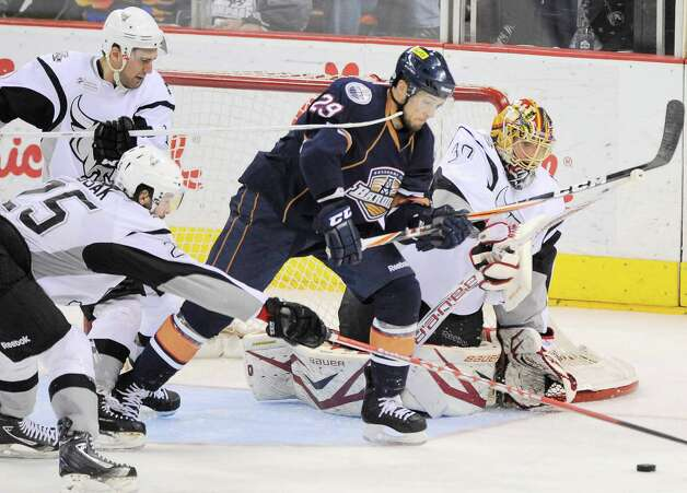San Antonio Rampage goaltender Jacob Markstrom, right, defends the net against Oklahoms City Barons' Chris VandeVelde (29) during the second period of an AHL hockey game, Monday, May 7, 2012, in San Antonio. Photo: Darren Abate, Darren Abate/pressphotointl.com / Darren Abate/pressphotointl.com