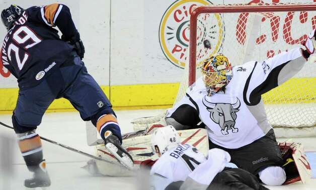 Oklahoma City Barons' Chris VandeVelde, left, scores the game-winning goal against San Antonio Rampage goaltender Jacob Markstrom during the overtime period of an AHL hockey game, Monday, May 7, 2012, in San Antonio. Oklahoma City won 2-1. Photo: Darren Abate, Darren Abate/pressphotointl.com / Darren Abate/pressphotointl.com