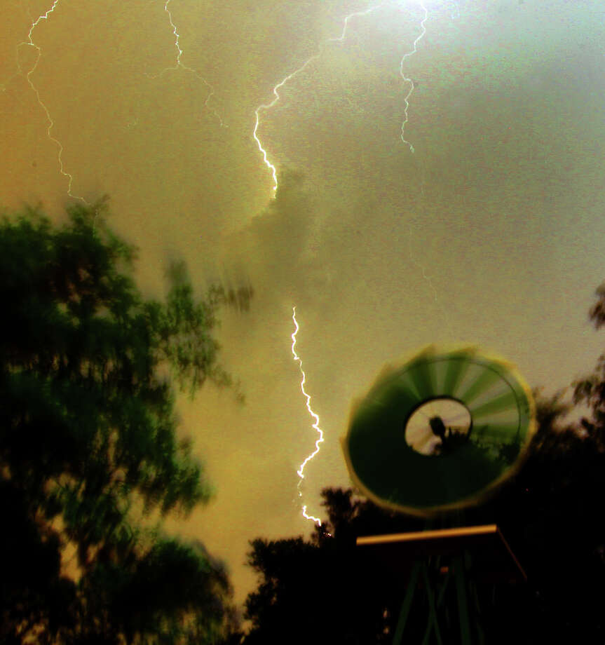 Lightning flashes in north San Antonio as storms move into the area Monday night, May 7, 2012. Nearly 7,000 homes reported losing electrical power. Photo: John Davenport, San Antonio Express-News