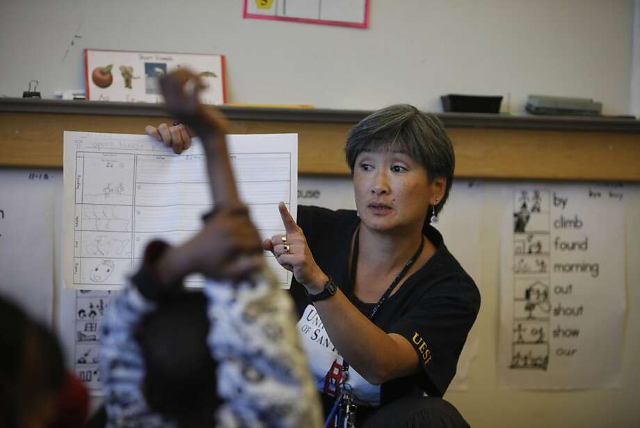 Darcie Chan Blackburn goes over a class assignment with her first grade english language development class at Sheridan Elementary School on Friday, May 4, 2012 in San Francisco, Calif. Currently Chan Blackburn has a class of 20 but it could increase under the proposed contract. Photo: Lea Suzuki, The Chronicle