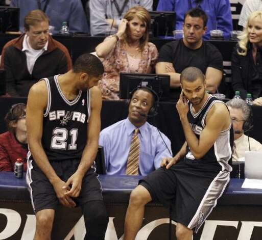 The Spurs' Tim Duncan and Tony Parker talk with former Spur Sean Elliott during the second half of Game 4 in the Western Conference first round at EnergySolutions Arena in Salt Lake City, Monday, May 7, 2012. The Spurs beat the Utah Jazz, 87-81, and swept the series, 4-0. Jerry Lara/San Antonio Express-News (Jerry Lara / San Antonio Express-News)