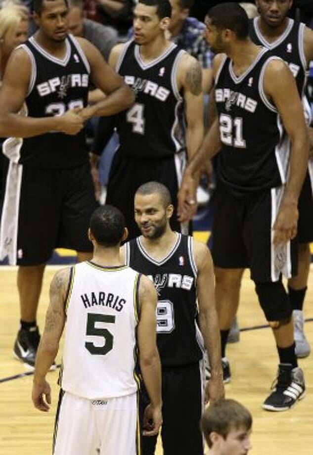 The Spurs'  Tony Parker talks with the Jazz's Devin Harris during the second half of Game 4 in the Western Conference first round at EnergySolutions Arena in Salt Lake City, Monday, May 7, 2012. The Spurs won 87-81 and swept the series, 4-0. Jerry Lara/San Antonio Express-News (Jerry Lara / San Antonio Express-News)
