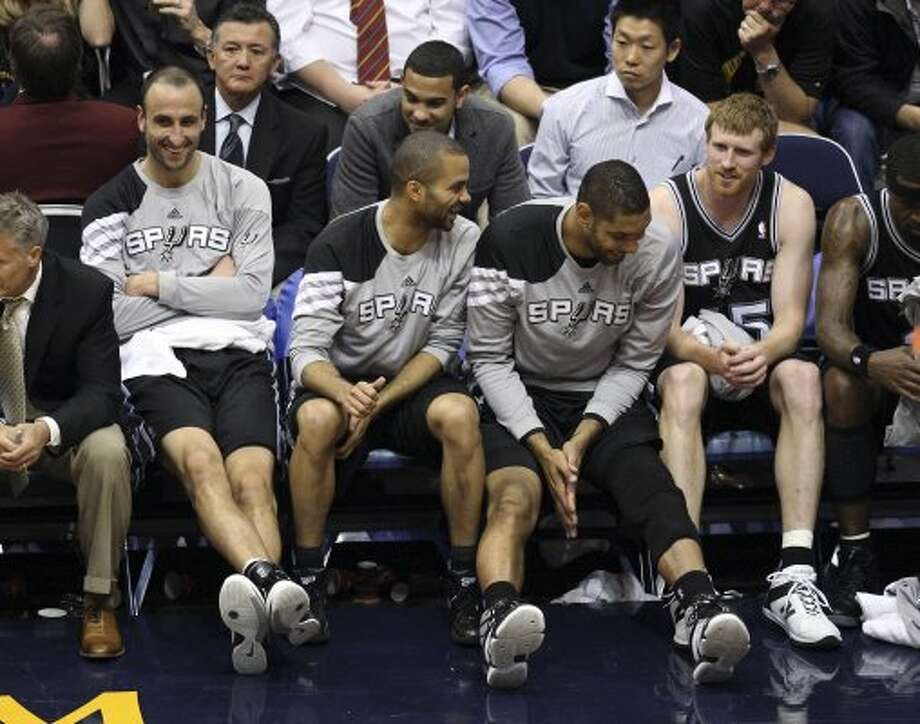 The Spurs'  Manu Ginobili, Tony Parker, Tim Duncan and Matt Bonner share a laugh during the second half of Game 4 in the Western Conference first round at EnergySolutions Arena in Salt Lake City, Monday, May 7, 2012. The Spurs beat the Utah Jazz, 87-81, and swept the series, 4-0. Jerry Lara/San Antonio Express-News (Jerry Lara / San Antonio Express-News)