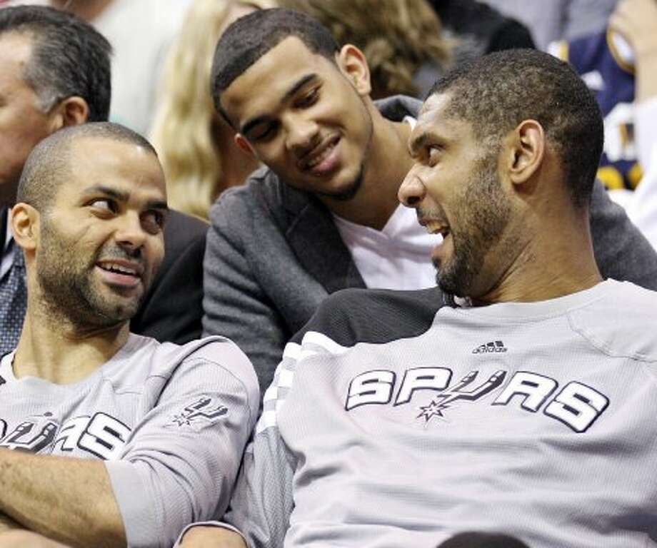 The Spurs' Tony Parker (from left), Cory Joseph, and Tim Duncan joke while on the bench during second half action of Game 4 of the Western Conference first round against the  Jazz  Monday May 7, 2012 at EnergySolutions Arena in Salt Lake City, Utah. The Spurs won 87-81. EDWARD A. ORNELAS/SAN ANTONIO EXPRESS-NEWS (EDWARD A. ORNELAS / SAN ANTONIO EXPRESS-NEWS)