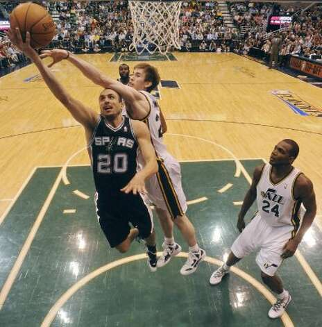 The Spurs' Manu Ginobili shoots around the Jazz's Gordon Hayward as Jazz's Paul Millsap looks on during first half action of Game 4 of the Western Conference first round Monday May 7, 2012 at EnergySolutions Arena in Salt Lake City, Utah. EDWARD A. ORNELAS/SAN ANTONIO EXPRESS-NEWS (EDWARD A. ORNELAS / SAN ANTONIO EXPRESS-NEWS)