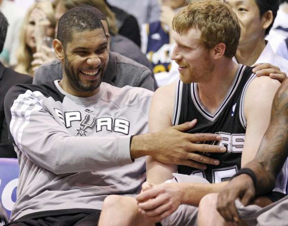 The Spurs' Tim Duncan hugs teammate Spurs' Matt Bonner during second half action of Game 4 of the Western Conference first round against the Jazz Monday May 7, 2012 at EnergySolutions Arena in Salt Lake City, Utah. The Spurs won 87-81. EDWARD A. ORNELAS/SAN ANTONIO EXPRESS-NEWS (EDWARD A. ORNELAS / SAN ANTONIO EXPRESS-NEWS)