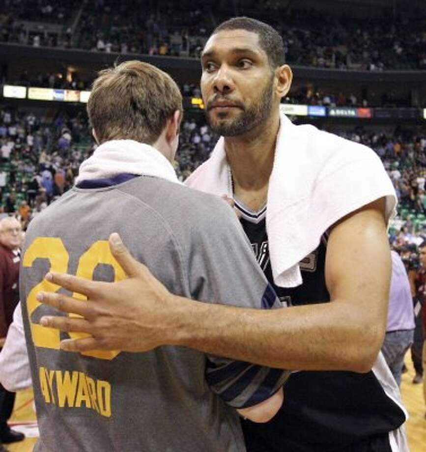 The Spurs' Tim Duncan hugs Jazz's Gordon Hayward after Game 4 of the Western Conference first round Monday May 7, 2012 at EnergySolutions Arena in Salt Lake City, Utah. The Spurs won 87-81. EDWARD A. ORNELAS/SAN ANTONIO EXPRESS-NEWS (EDWARD A. ORNELAS / SAN ANTONIO EXPRESS-NEWS)