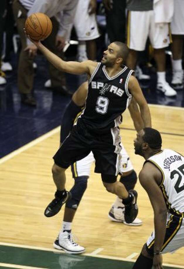 The Spurs'  Tony Parker drives to the basket as the Jazz's Al Jefferson looks on during the second half of game four in the Western Conference first round at EnergySolutions Arena in Salt Lake City, Monday, May 7, 2012. The Spurs won 87-81 and swept the series, 4-0. Jerry Lara/San Antonio Express-News (Jerry Lara / San Antonio Express-News)