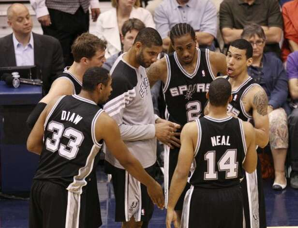 The Spurs' Tim Duncan talks with the team during a break in the second half of Game 4 in the Western Conference first round at EnergySolutions Arena in Salt Lake City, Monday, May 7, 2012. The Spurs beat the Utah Jazz, 87-81, and swept the series, 4-0. Jerry Lara/San Antonio Express-News (Jerry Lara / San Antonio Express-News)
