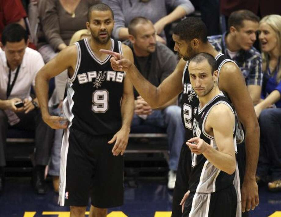 The Spurs'  Tony Parker, Tim Duncan and Manu Ginobili talk to each other during a break in the first half of game four in the Western Conference first round at EnergySolutions Arena in Salt Lake City, Monday, May 7, 2012.   Jerry Lara/San Antonio Express-News (Jerry Lara / San Antonio Express-News)