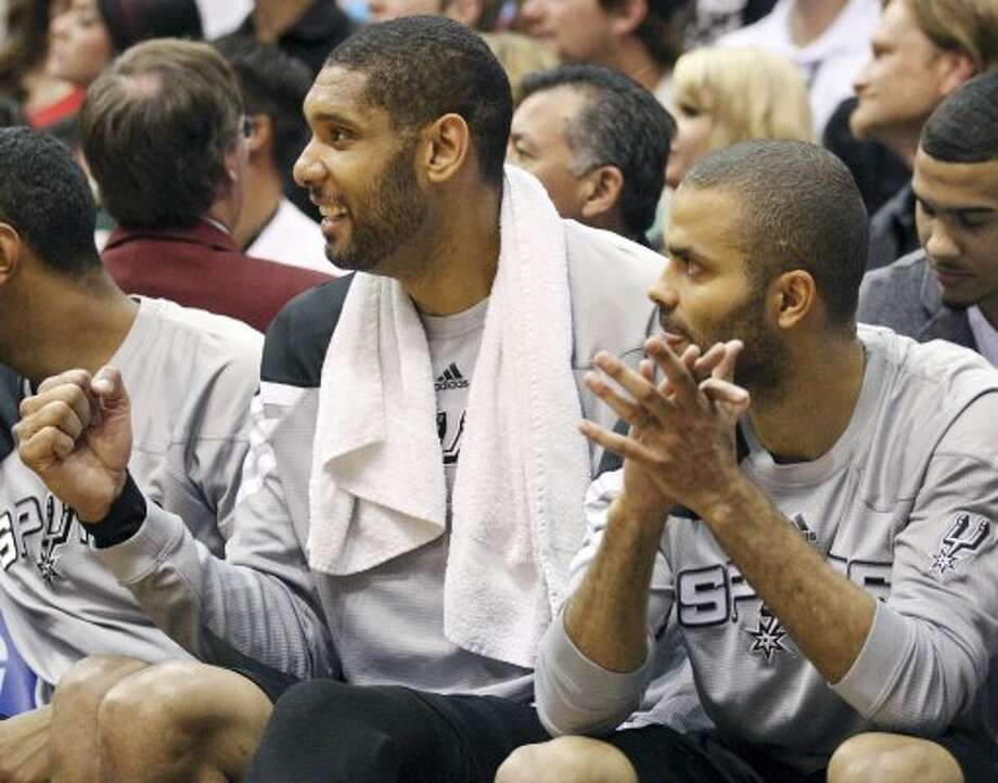 The Spurs' Tim Duncan and Tony Parker celebrate after a score during second half action of Game 4 of the Western Conference first round against the Jazz Monday May 7, 2012 at EnergySolutions Arena in Salt Lake City, Utah. The Spurs won 87-81. EDWARD A. ORNELAS/SAN ANTONIO EXPRESS-NEWS (EDWARD A. ORNELAS / SAN ANTONIO EXPRESS-NEWS)