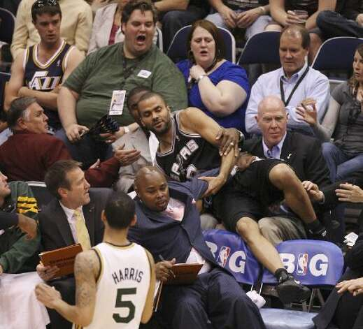 The Spurs'  Tony Parker land in the crowd after her was fouled by the Jazz's Devin Harris during the second half of Game 4 in the Western Conference first round at EnergySolutions Arena in Salt Lake City, Monday, May 7, 2012. The Spurs won 87-81 and swept the series, 4-0. Jerry Lara/San Antonio Express-News (Jerry Lara / San Antonio Express-News)