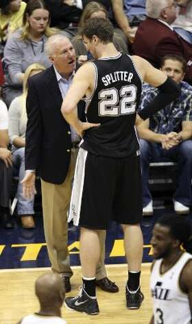 Spurs coach Gregg Popovich talks with Tiago Splitter during the second half of Game 4 in the Western Conference first round at EnergySolutions Arena in Salt Lake City, Monday, May 7, 2012. The Spurs beat the Utah Jazz, 87-81, and swept the series, 4-0. Jerry Lara/San Antonio Express-News (Jerry Lara / San Antonio Express-News)
