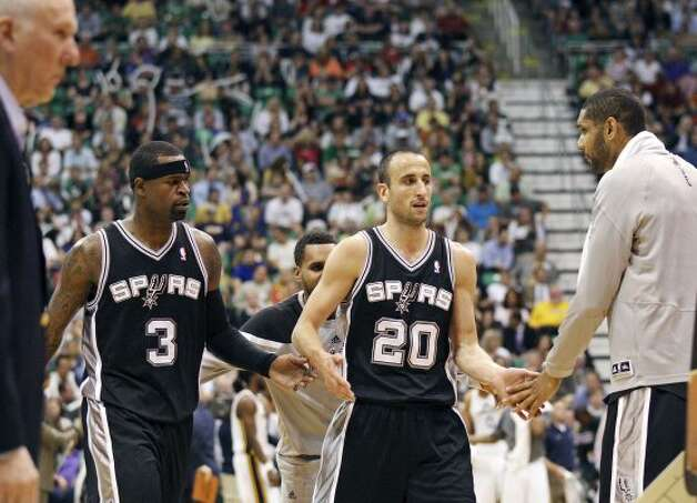 The Spurs' Stephen Jackson (from left) and Manu Ginobili are met by teammate Tim Duncan as they walk off the court during a second half timeout of Game 4 of the Western Conference first round Monday May 7, 2012 at EnergySolutions Arena in Salt Lake City, Utah. The Spurs won 87-81. EDWARD A. ORNELAS/SAN ANTONIO EXPRESS-NEWS (EDWARD A. ORNELAS / SAN ANTONIO EXPRESS-NEWS)