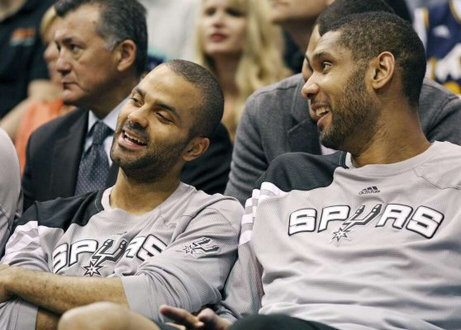 The Spurs' Tony Parker and Tim Duncan are all smiles while on the bench during second half action of Game 4 of the Western Conference first round against the Jazz Monday May 7, 2012 at EnergySolutions Arena in Salt Lake City, Utah. The Spurs won 87-81. EDWARD A. ORNELAS/SAN ANTONIO EXPRESS-NEWS (EDWARD A. ORNELAS / SAN ANTONIO EXPRESS-NEWS)