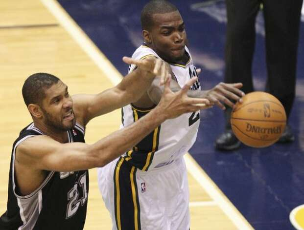 The Spurs'  Tim Duncan goes for a rebound against the Jazz's Paul Millsap during the second half of Game 4 in the Western Conference first round at EnergySolutions Arena in Salt Lake City, Monday, May 7, 2012. The Spurs won 87-81 and swept the series, 4-0. Jerry Lara/San Antonio Express-News (Jerry Lara / San Antonio Express-News)