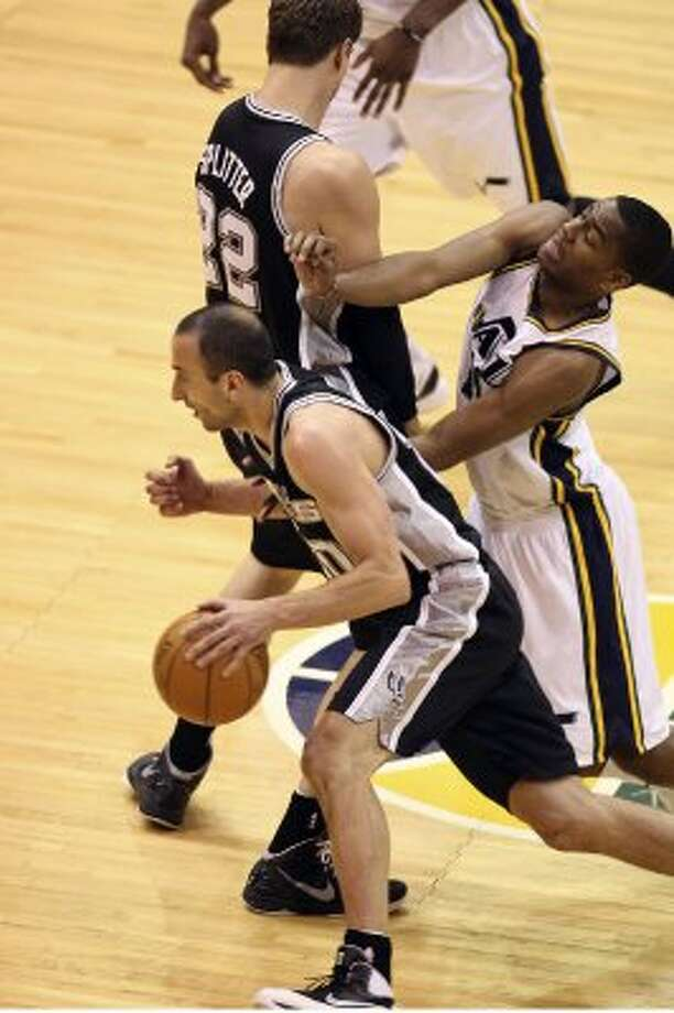 The Spurs'  Manu Ginobili drives as Tiago Splitter screens the Jazz's Alec Burks during the second half of Game 4 in the Western Conference first round at EnergySolutions Arena in Salt Lake City, Monday, May 7, 2012. The Spurs won 87-81 and swept the series, 4-0. Jerry Lara/San Antonio Express-News (Jerry Lara / San Antonio Express-News)