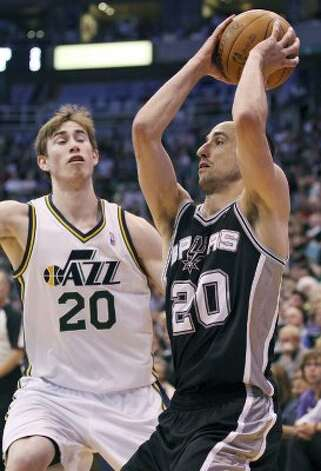 The Spurs' Manu Ginobili looks for room around the Jazz's Gordon Hayward during first half action of Game 4 of the Western Conference first round Monday May 7, 2012 at EnergySolutions Arena in Salt Lake City, Utah. EDWARD A. ORNELAS/SAN ANTONIO EXPRESS-NEWS (EDWARD A. ORNELAS / SAN ANTONIO EXPRESS-NEWS)