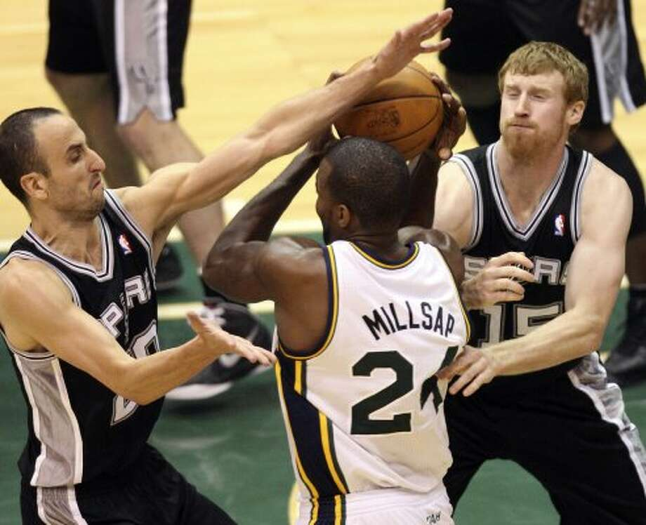 The Spurs'  Manu Ginobili and Matt Bonner cover the Jazz's Paul Millsap during the second half of Game 4 in the Western Conference first round at EnergySolutions Arena in Salt Lake City, Monday, May 7, 2012. The Spurs won 87-81 and swept the series, 4-0. Jerry Lara/San Antonio Express-News (Jerry Lara / San Antonio Express-News)
