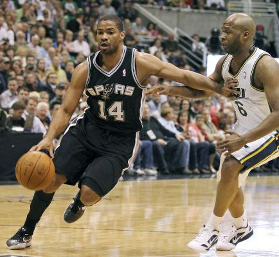 The Spurs' Gary Neal drives around the Jazz's Jamaal Tinsley during first half action of Game 4 of the Western Conference first round Monday May 7, 2012 at EnergySolutions Arena in Salt Lake City, Utah. EDWARD A. ORNELAS/SAN ANTONIO EXPRESS-NEWS (EDWARD A. ORNELAS / SAN ANTONIO EXPRESS-NEWS)