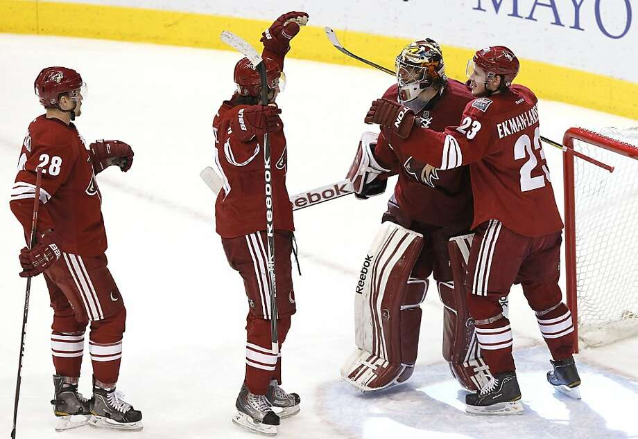Phoenix Coyotes' Mike Smith, second from right, celebrates a series win over the Nashville Predators with teammates Lauri Korpikoski (28), of Finland, Oliver Ekman-Larsson (23), of Sweden, and Antoine Vermette after the third period during Game 5 in an NHL hockey Stanley Cup Western Conference semifinal playoff series Monday, May 7, 2012, in Glendale, Ariz.  The Coyotes defeated the Predators 2-1, and advance to the Western Conference finals.(AP Photo/Ross D. Franklin) Photo: Ross D. Franklin, Associated Press