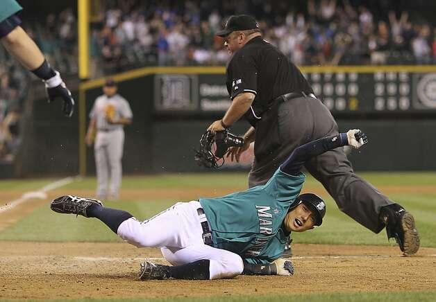 SEATTLE, WA - MAY 07:  Munenori Kawasaki #61 of the Seattle Mariners scores the winning run in a 3-2 defeat of the Detroit Tigers at Safeco Field on May 7, 2012 in Seattle, Washington. (Photo by Otto Greule Jr/Getty Images) Photo: Otto Greule Jr, Getty Images