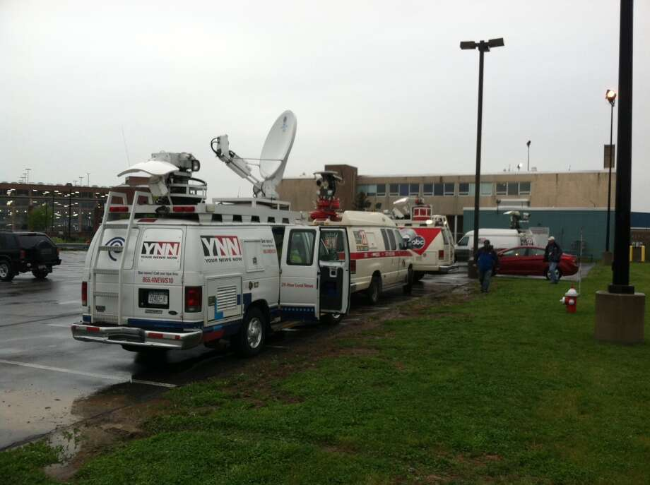 Television news trucks line up for the arrival Tuesday of Air Force One at Albany International Airport. President Barack Obama is making his third visit to the Capital Region and will give a speech on the economy at the College of Nanoscale Science and Engineering of the University at Albany. (Skip Dickstein / Times Union)