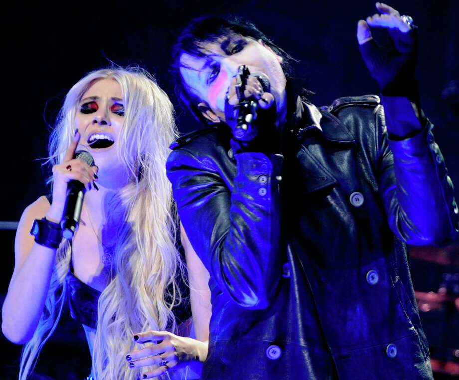 Marilyn Manson and actress Taylor Momsen (who also fronts the rock band The Pretty Reckless) perform at the 2012 Revolver Golden Gods Award Show at Club Nokia on April 11, 2012 in Los Angeles, California. Photo: Frazer Harrison, Getty Images / 2012 Getty Images