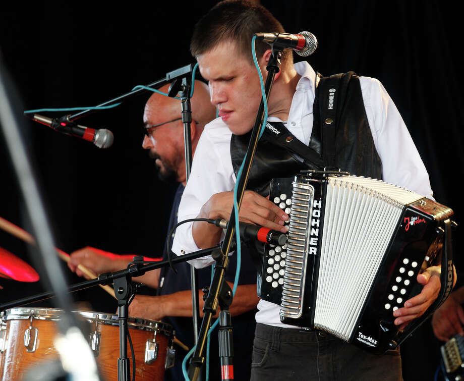 "METRO; TEJANO CONJUTOFEST JMS; 05/13/11; The 30th Annual Tejano Conjunto Festival kicks off at Rosedale Park with Juanito Castillo y Grupo Inovacion, Friday, May 13, 2011 in San Antonio. Castillo is a 22-year-old accordion protégé of the late Esteban ""Steve"" Jordan, here playing with Jordan's brother, Bonifacio ""Boni"" Jordan, left, on timbales.( Photo by J. Michael Short / SPECIAL ) Photo: J. Michael Short, SPECIAL TO THE EXPRESS-NEWS / THE SAN ANTONIO EXPRESS-NEWS"