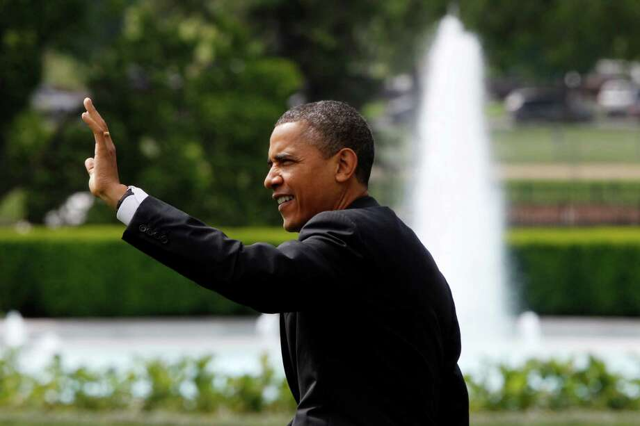 President Barack Obama waves as he walks on the South Lawn of the White House in Washington, Tuesday, May 8, 2012, as he travels to Albany, N.Y. Photo: Charles Dharapak, AP / AP