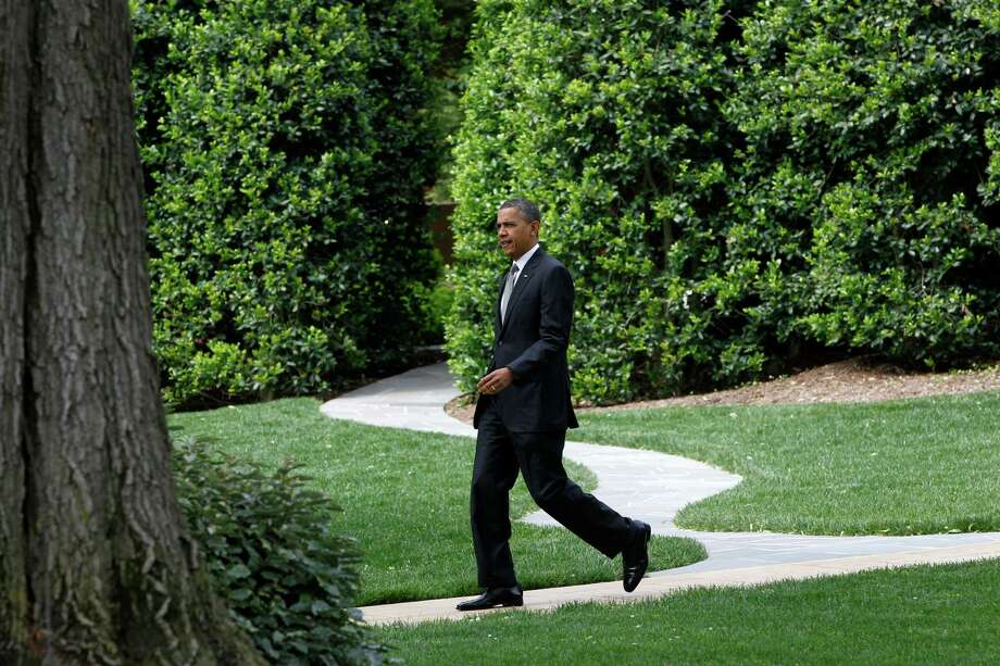President Barack Obama walks on the South Lawn of the White House in Washington, Tuesday, May 8, 2012, as he travels to Albany, N.Y. Photo: Charles Dharapak, AP / AP