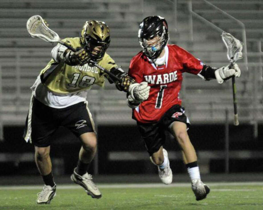 Fairfield Warde's Kyle Scheetz, pictured here in the Mustangs' April 5 game against Trumbull, scored two goals in Warde's state playoff clinching win over Bunnell on Friday night in Fairfield. Photo: File Photo