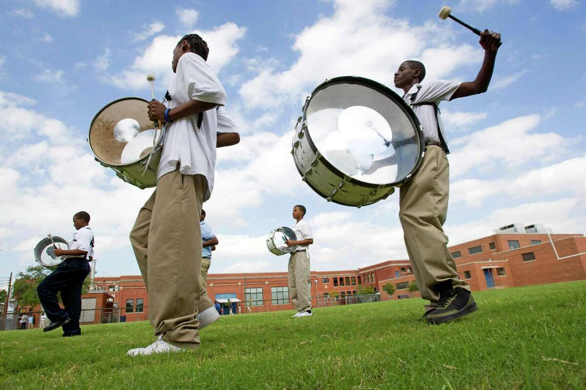 Drum line members from Ryan Middle School are shown rehearsing at the school in this file photo from 2009. HISD had contemplated closing the school because of declining enrollment.