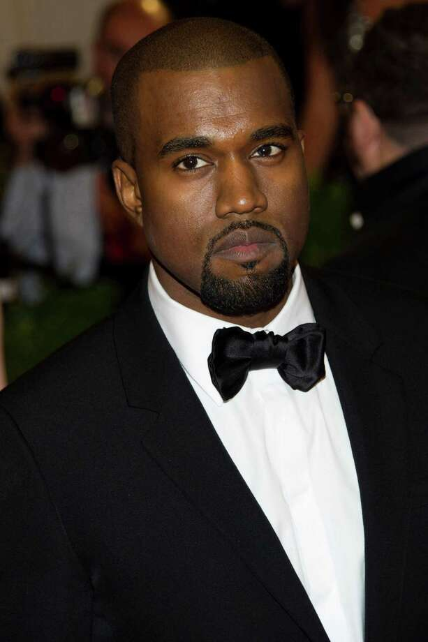 Kanye West arrives at the Metropolitan Museum of Art Costume Institute gala benefit, celebrating Elsa Schiaparelli and Miuccia Prada, Monday, May 7, 2012 in New York. (AP Photo/Charles Sykes) Photo: Charles Sykes, Associated Press / FR170266 AP