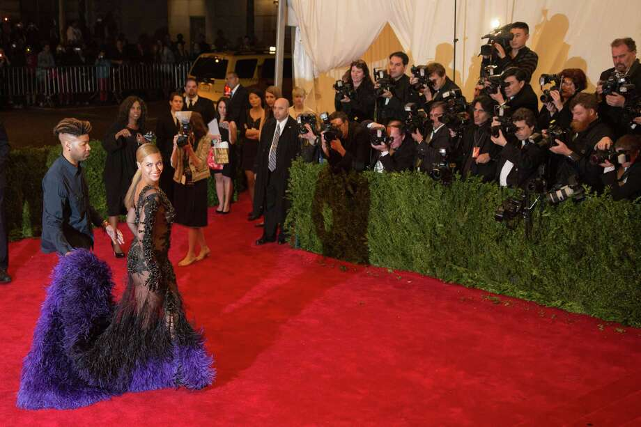 Beyonce arrives at the Metropolitan Museum of Art Costume Institute gala benefit, celebrating Elsa Schiaparelli and Miuccia Prada, Monday, May 7, 2012 in New York. (AP Photo/Charles Sykes) Photo: Charles Sykes, Associated Press / FR170266 AP