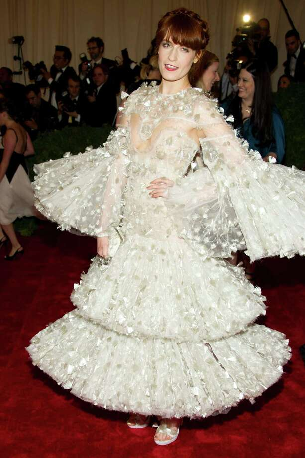 Florence Welch arrives at the Metropolitan Museum of Art Costume Institute gala benefit, celebrating Elsa Schiaparelli and Miuccia Prada, Monday, May 7, 2012 in New York. (AP Photo/Charles Sykes) Photo: Charles Sykes, Associated Press / FR170266 AP