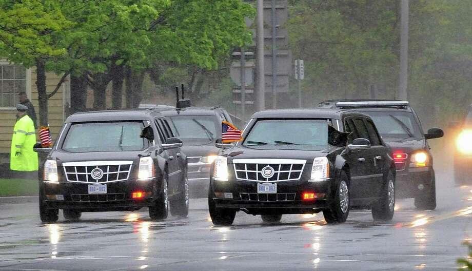 President Barack Obama's motorcade makes its way Tuesday along Albany Shaker Road after leaving Albany International Airport. (John Carl D'Annibale / Times Union) Photo: John Carl D'Annibale / 00017555C