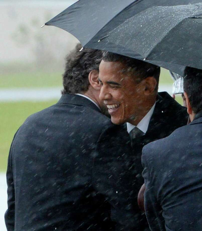President Barack Obama is greeted by Gov. Andrew Cuomo, left, as he arrives Tuesday at Albany International Airport. (Skip Dickstein / Times Union) Photo: SKIP DICKSTEIN / 2012