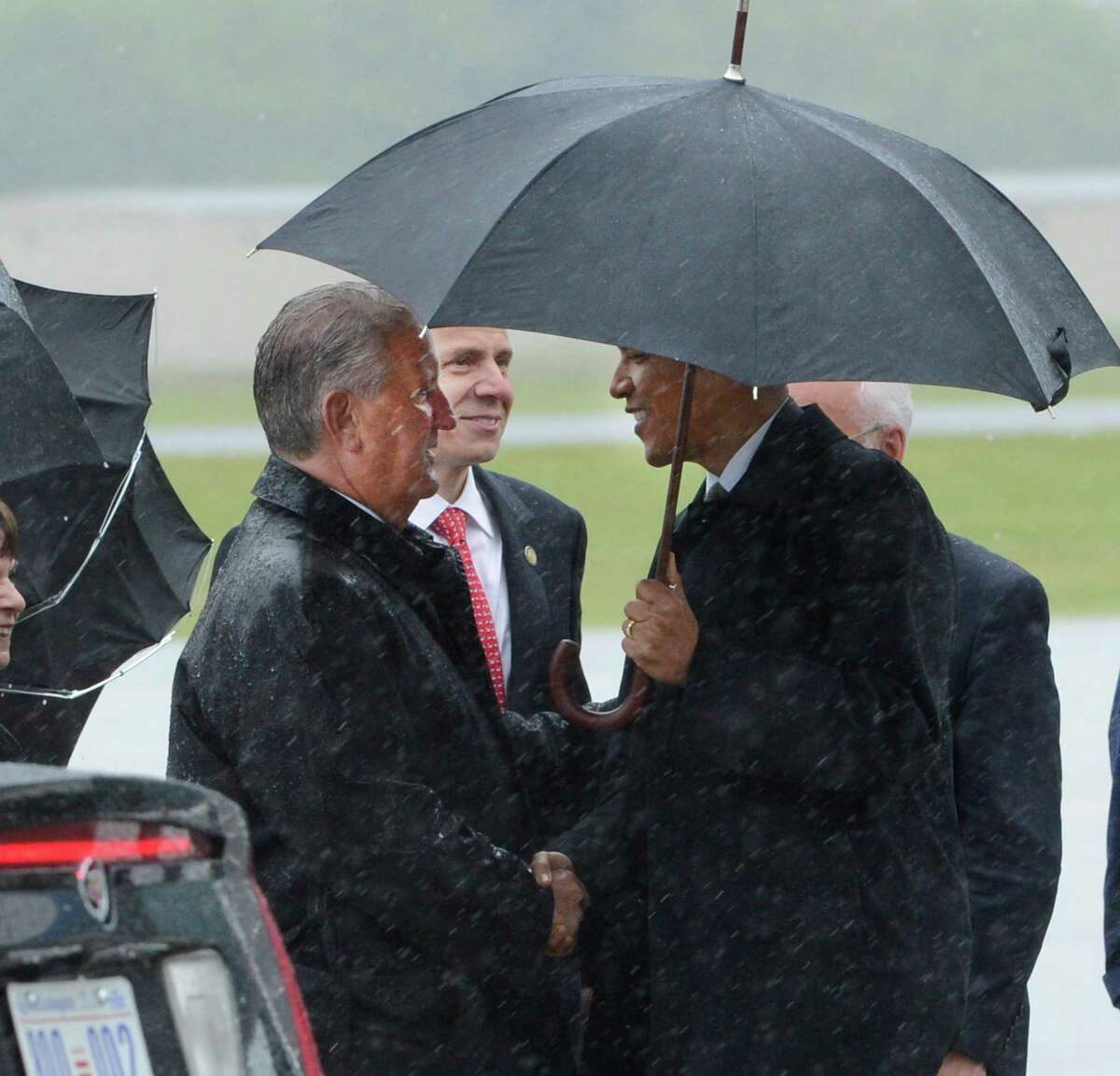 President Barack Obama is greeted by Albany Mayor Jerry Jennings as he arrives Tuesday at Albany International Airport. (Skip Dickstein / Times Union)