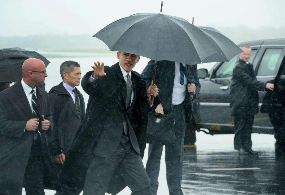 President Barack Obama arrives Tuesday at  Albany International Airport.  (Skip Dickstein / Times Union) Photo: SKIP DICKSTEIN / 2012